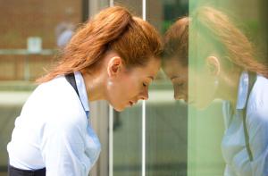 women brunette leaning on window frustration